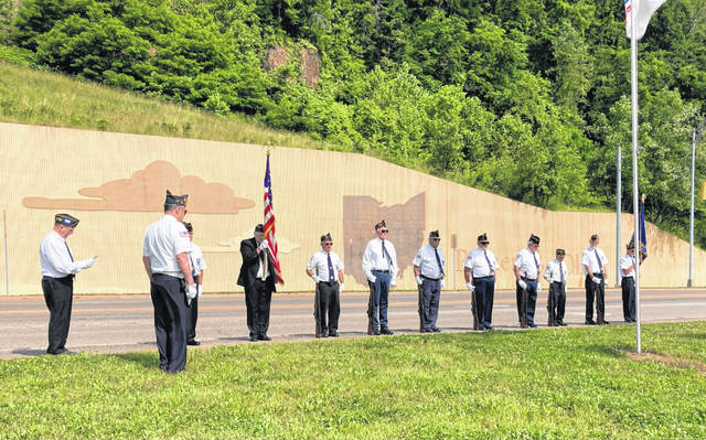 Post 39 members gather that the Bridge of Honor for a Memorial Day ceremony.