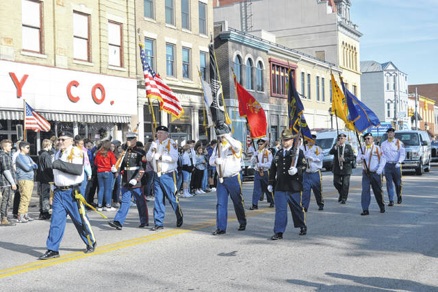 Pictured from a previous Gallipolis Veterans Day Parade is VFW Post 4464 Honor Guard and colleagues with the colors displayed.