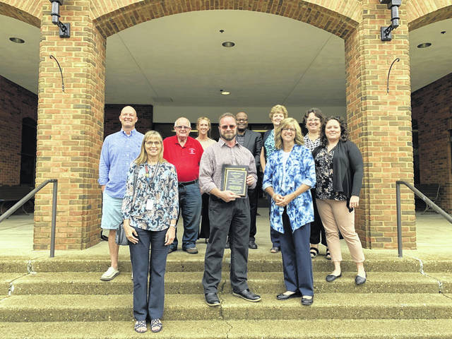 Thom Mollohan, pictured in the center of the front row, was recently recognized by Gallia CPR and the City of Gallipolis. Also pictured are members of Gallia CPR.