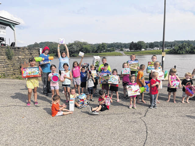 Children with their prizes from Kickin' Summer Bash.
