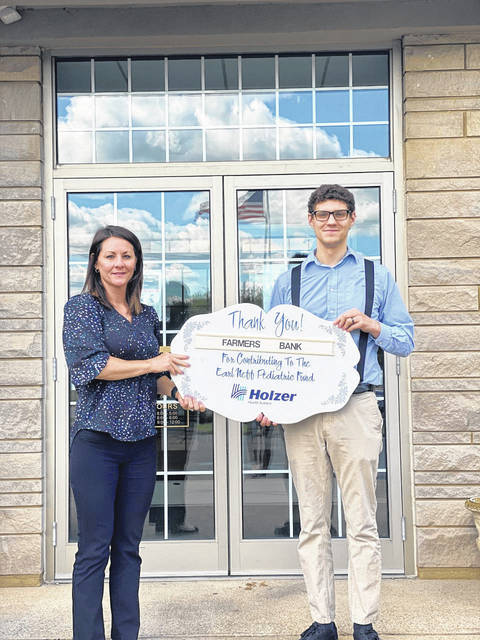 Farmers Bank, represented here by Brittany Amanda Pearce and Baron Dummitt, is a recent sponsor of the Holzer Pediatric Fund.