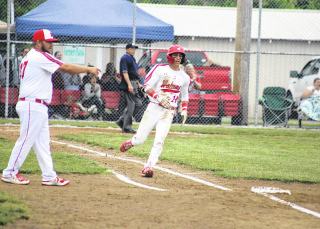 Wahama sophomore Aaron Henry looks to round first base after a hit in a June 2 baseball game in Mason, W.Va.