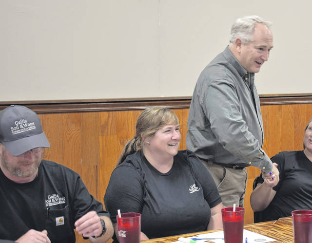 Ohio Auditor of State Keith Faber (R), pictured standing, greets guests at the Gallia County Farm Bureau luncheon on Thursday. Faber also visited with Gallia County Commissioners.