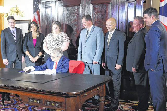 State Rep. Jason Stephens attended the signing ceremony with Gov. Mike DeWine on Thursday for House Bill 201.