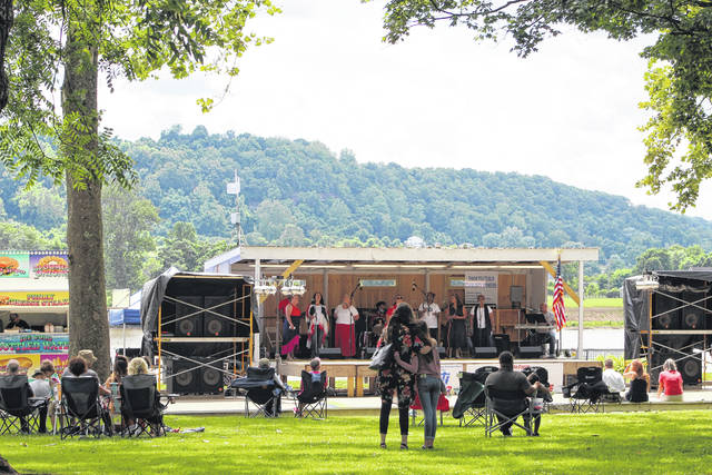 The Gallipolis River Recreation Festival returned on Friday to First Avenue and Gallipolis City Park. Here, visitors listen to performances of gospel and contemporary Christian music.
