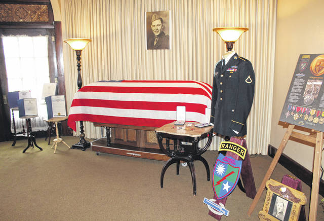 The military uniform, medals and other items of the late Army PFC James Wilmer White will be displayed at the Chester Courthouse Museum. The items are pictured here as part of the display at the funeral service held in June at Ewing-Schwarzel Funeral Home in Pomeroy.