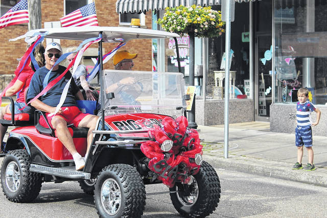 """Jim Stearns and Jan Haddox in their """"Big Blacks"""" football-themed golf cart participated in the last Liberty Fest parade. This year's parade takes place at 6:30 p.m. this Sunday."""