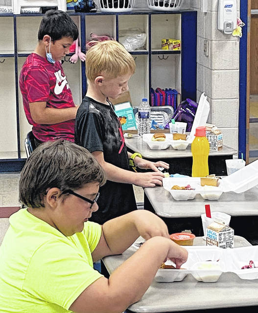 Southern students eat a meal during the summer school program.