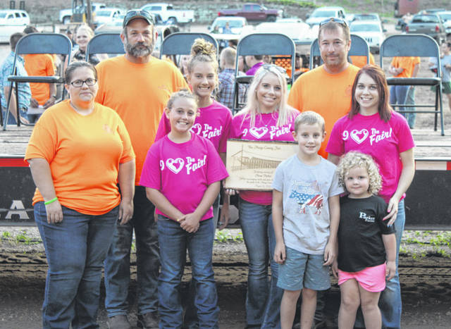 The family of Anna Parker was presented with a plaque during the opening ceremony of the 2021 Meigs County Fair.