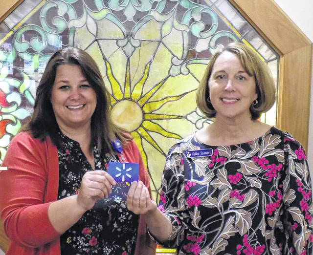 Holzer Senior Care Center recently presented a $100 gift card to Bossard Memorial Library, with these funds to be used for library programming. Pictured from left are Stacy Hall, admissions coordinator, Holzer Senior Care Center and Debbie Saunders, Bossard Library director.