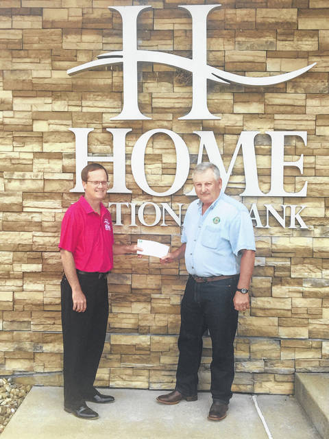 Home National Bank is the 2021 sponsor of the CHSA Meigs County Treasure Hunt. Pictured are HNB President John Hoback presenting a check to Treasure Hunt organizer Jim Smith.