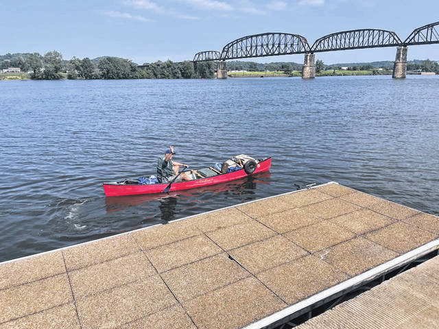 Adventurer and canoeist, Neal Moore, departs Riverfront Park in Point Pleasant earlier this week. He is canoing across the country.