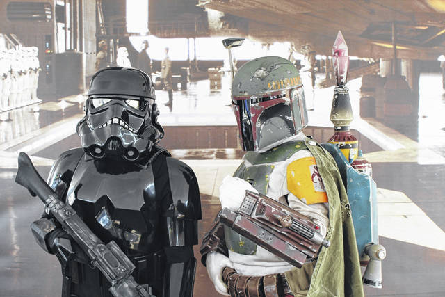 Pictured are members of the 501st Legion/Garrison Corellia greeting visitors to the Mothman Festival in 2019. The festival, as well as the upcoming Gallipolis Comics and Creators Convention, has embraced cosplay, which is a portrayal of popular characters in comics, TV and movies. The family-friendly convention returns this Sunday and the festival in September.