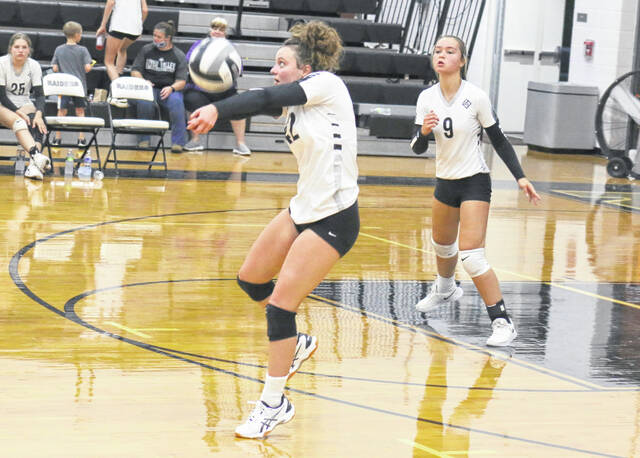 River Valley junior Madison Hall (42) bumps a ball in the air during a Sept. 9 volleyball contest against Meigs in Bidwell, Ohio.