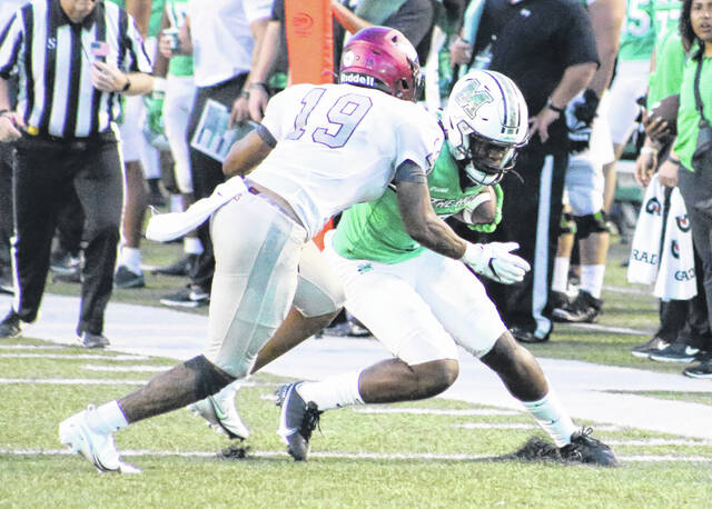 Marshall wide receiver Corey Gammage attempts to shake off North Carolina Central defensive back Justin Nicholson during a Sept. 11 football game at Joan C. Edwards Stadium in Huntington, W.Va.