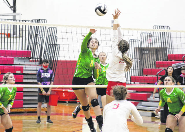 Eastern junior Bella Mugrage (8) hits a spike attempt during Tuesday night's TVC Hocking volleyball match against South Gallia in Mercerville, Ohio.