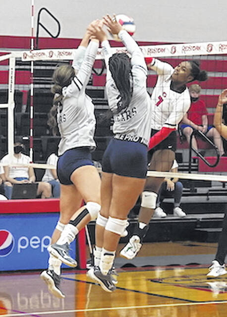 Rio Grande's Shalea Byrd goes up for an attack against a pair of Shawnee State defenders during the RedStorm's 3-0 Friday night loss to the Bears in the Emileigh Cooper Memorial Tournament at the Newt Oliver Arena.