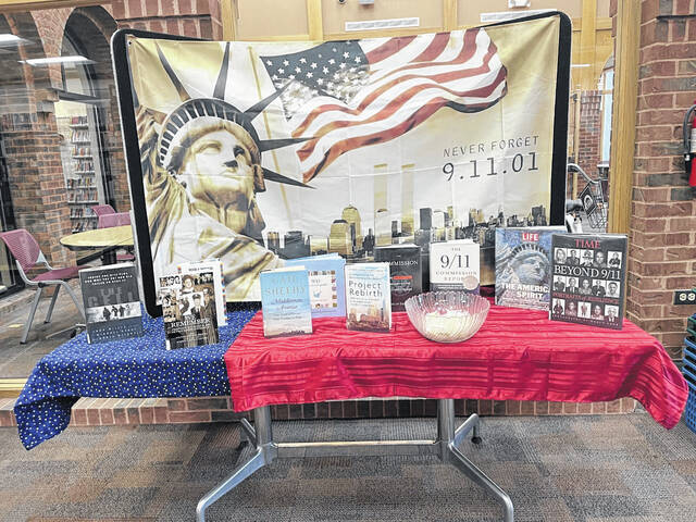 The Bossard Memorial Library has setup a commemorative 9/11 display with a selection of books and is offering lapel pins to patrons.