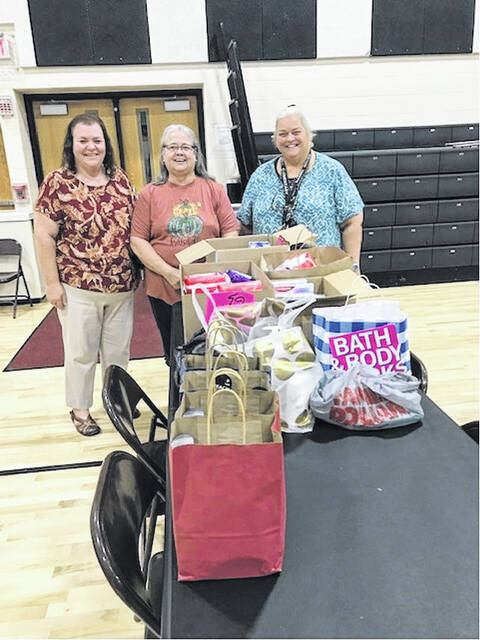 Pictured are Beta Alpha members, from left, Gwen Daniels, Debbie North and Bambi Roush, presenting a donation of personal care and hygiene items that were collected by the group to be given to the Oak Hill Middle School.