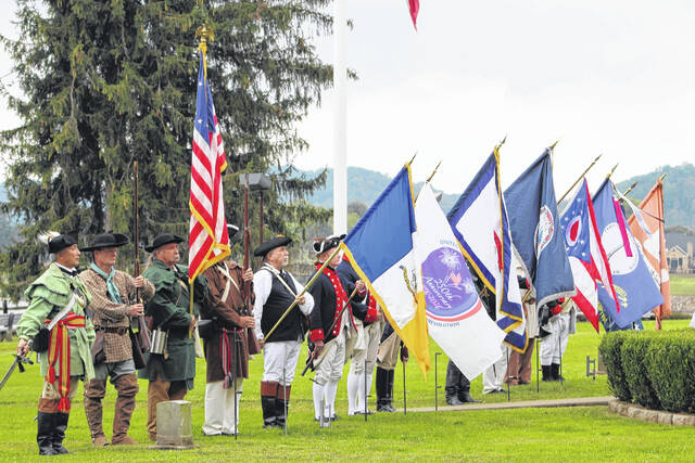 The combined color guard of the Sons of the American Revolution under the director of Commander Bob Hill, of the Ohio State Color Guard, is pictured on Sunday at the Battle of Point Pleasant Memorial Service.