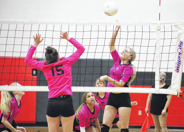 Point Pleasant sophomore Addysen Lewis spikes the ball against the Chapmanville Lady Tigers in a volleyball game Tuesday evening in Point Pleasant, W. Va.