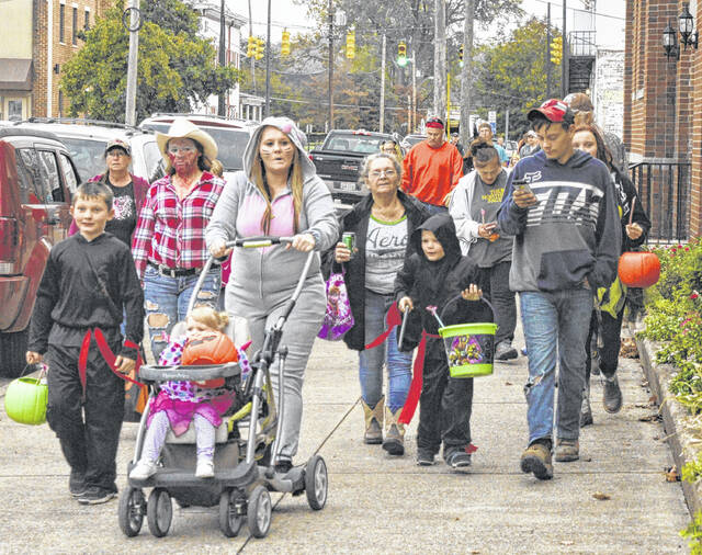 Trick-or-treaters fill the streets of Gallipolis in a previous year, prior to COVID-19.