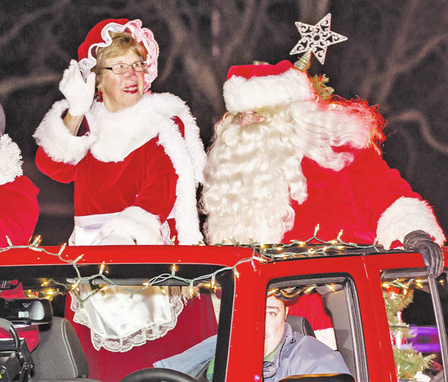 Santa and Mrs. Claus arrive at city hall to light the tree in the 2016 Miracle on Main Street celebration.