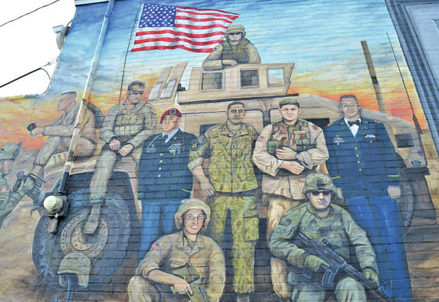 A downtown mural bears the likenesses of Air Force Airman 1st Class Eric Barnes of Lorain, Army Sgt. Benjamin Biskie of Vermilion, Marine Corps Lance Cpl. Ryan Giese of Lorain, Marine Corps Lance Cpl. David Hall of Lorain, Army Staff Sgt. James Hunter of South Amherst, Army Capt. Michael Medders of Avon Lake, Army Sgt. Daniel Shepherd of Elyria, Army Sgt. Norman Tollett of Elyria, Army Sgt. Louis Torres of Oberlin, and Army Master Sgt. Robert West of Elyria.