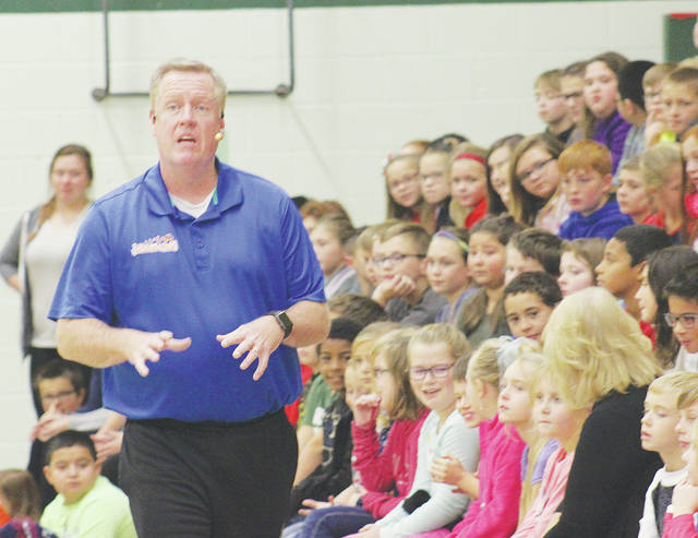 """Jim """"Basketball"""" Jones speaks to Nord Middle School students about bullying Nov. 28 while slipping in a few basketball spinning tricks."""