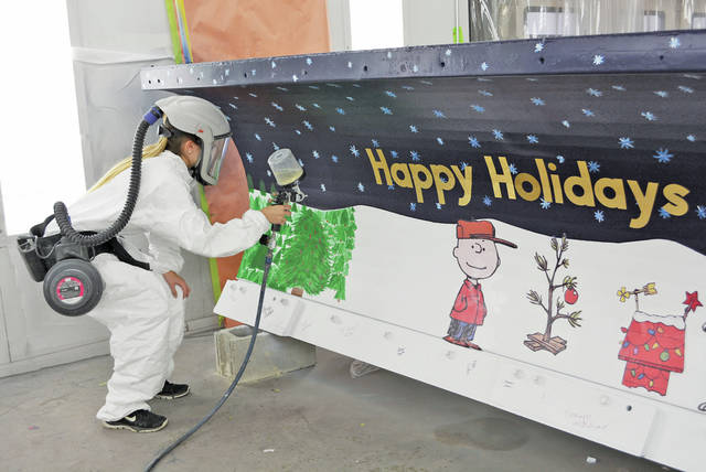 Student Madisyn Contreras applies the clear coat to an Ohio Department of Transportation snow plow blade at the Lorain County JVS.