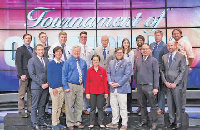 Andrew Pau is pictured among the 2017 Tournament of Champions contenders (front row, second from right). During the interview portion of Friday's show, he said he was recognized when a bunch of Amherst kids selling cookies rang his doorbell, he told host Alex Trebek.