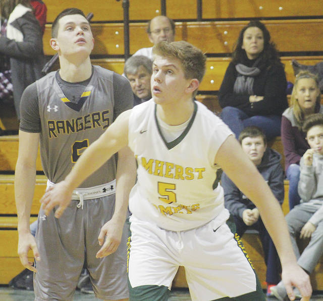 The Comets' Ryan Hritsko looks for room in the paint during Tuesday's 90-51 loss to the North Ridgeville Rangers.