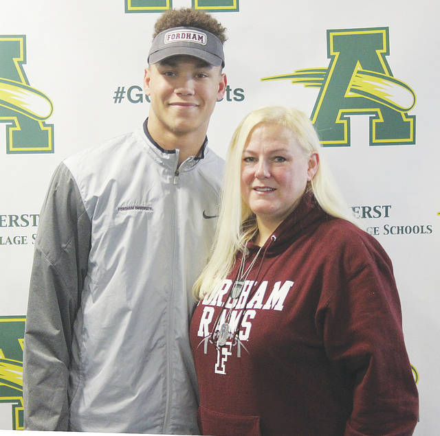Amherst Steele senior Devin Holmes has committed to playing football next year at Fordham University in New York City. In his first season at Steele, Holmes finished with 25 catches for 412 yards and six touchdowns. Here, he takes in the moment with his mother, Terasa, after signing on the dotted line.