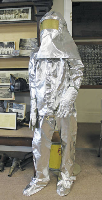 What looks like a shiny Hazmat suit or a trendy beekeepers outfit is actually an old Wellington firefighter's uniform on display at The Spirit of '76 museum.