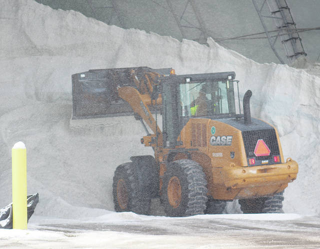 Salt is packed into a massive hangar behind the Ohio Department of Transportation's District III office just outside Oberlin. An average of 10,765 tons of salt is used in Lorain County every winter.