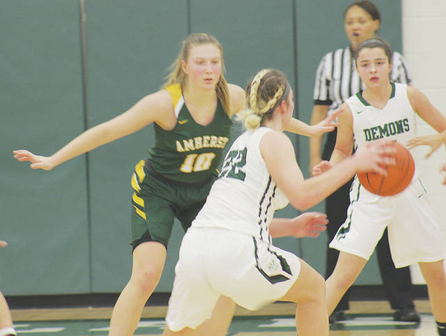 Kamryn Dziak defends Westlake's Gina Adams on the perimeter during the Comets' 42-39 SWC defeat.