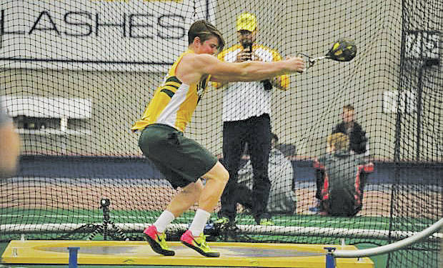 Jaret Prete competes in the weight throw at Kent State University, where he broke his own school record by more than four feet.