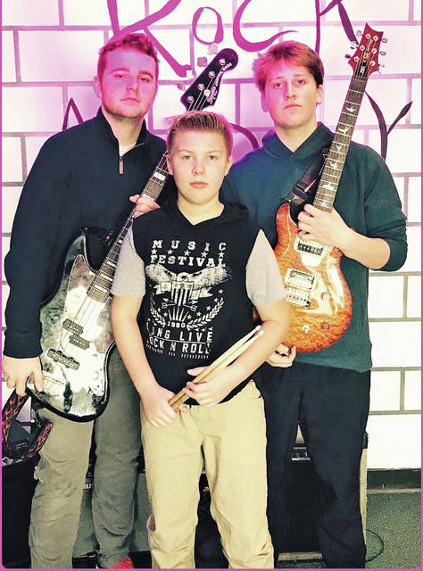 Norman Hobbs, Christian Gendics, and Mike Laub are the band Two Fisted Juice Box, which will compete in the 2018 High School Rock Off.