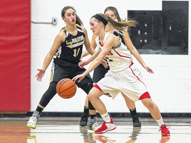 Firelands' Madison Palmer changes direction on offense while guarded by Black River's Lydia Wacker.