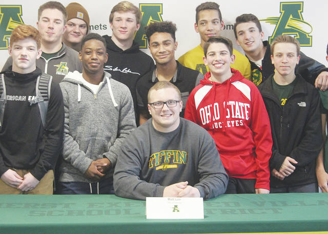 Friends and teammates surround Amherst Steele senior Matt Lee on Feb. 7 after he signed on the dotted line to play football for Tiffin University.