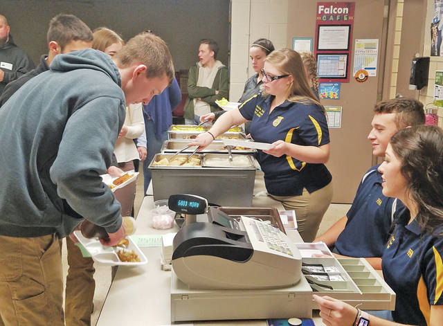 Students at Firelands High School use mock money to purchase breakfast based on income in a project by the FFA.