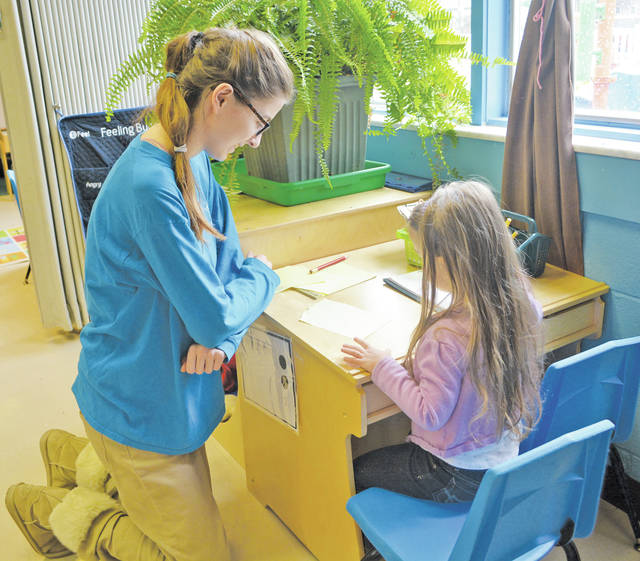 Alexis Weaver, a Lorain County JVS student from Wellington, works with a student at Head Start in Amherst.