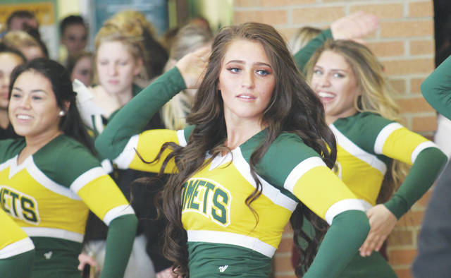 Steele cheerleader Rachel Machesky helps lead the celebration March 2 during a sendoff for cheer and track runners heading to state competition in Columbus.