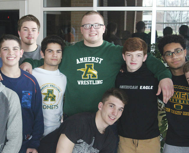 Amherst Steele wrestler Matt Lee is surrounded by teammates March 7 before heading off to Columbus for this year's state tournament.