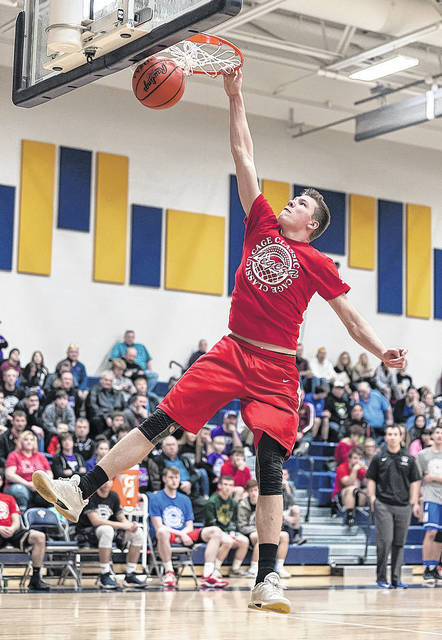 Firelands' Richard Maggard attacks the rim during the slam dunk contest.