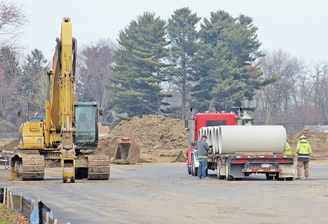 Large culvert pipes are delivered for installation by Herk Excavating of Vermilion, which was awarded early site work for the new Powers Elementary School. Foundation pouring could begin as early as the third week of May.