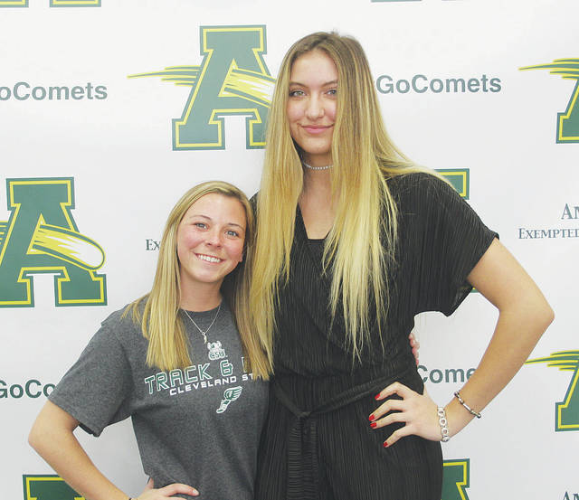 Steele seniors Brooke Armbruster and Faith Rico celebrate April 12 after signing their college commitment papers.