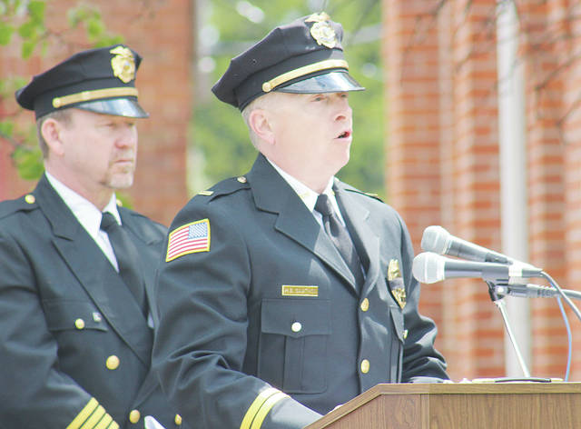 Amherst Lt. Mark Cawthon honors fallen officers alongside Wellington chief Tim Barfield on Thursday during the Lorain County Police Memorial.