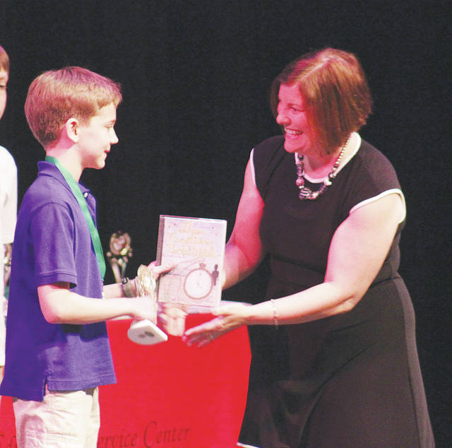Fireland's Aiden Bokulich is awarded a Best In Show writing award May 16 during the 36th Annual Lorain County Young Authors Conference.