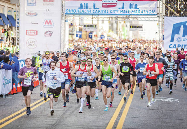 Runners take off at the start of the 2018 OhioHealth Capital City Half Marathon, held Saturday. Amherst native Josh Park led for nearly the entire race.
